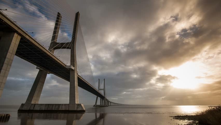 Time Lapse of Vasco da Gama Bridge over the Tagus river at sunrise with cloudy sky. Lisbon, Portugal. #5504084