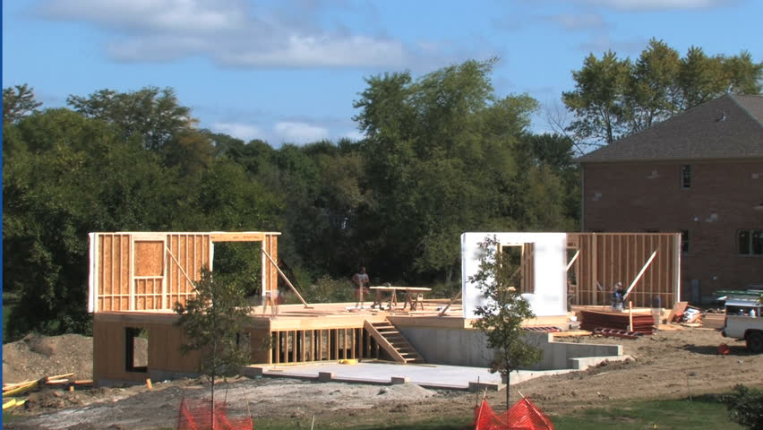 Time Lapse with stages of an entire luxury house being built from the ground up