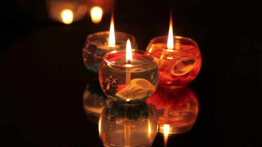 Burning Candles In The Dark Front Of Mirror Stock Footage