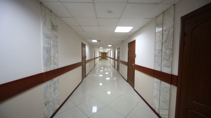 Switching on lights in hallway with brown doors and white floor