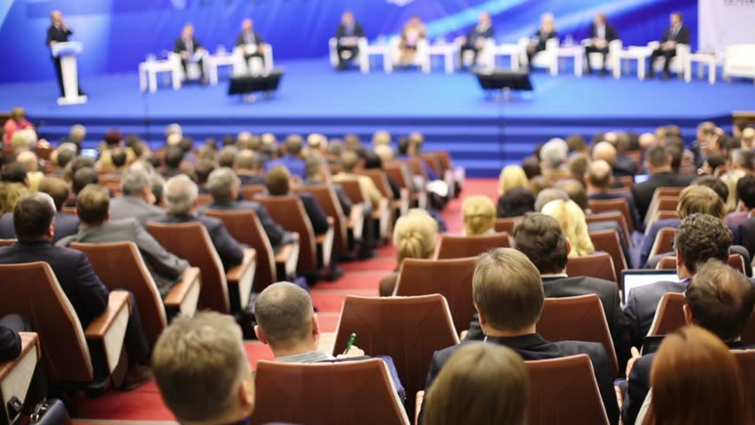 Back view rows seats with listeners sitting in large a hall