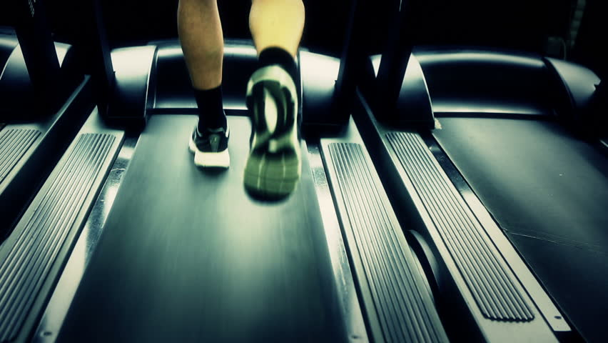 Exercising in the gym, treadmill cardio workout. Canon 5D MK III