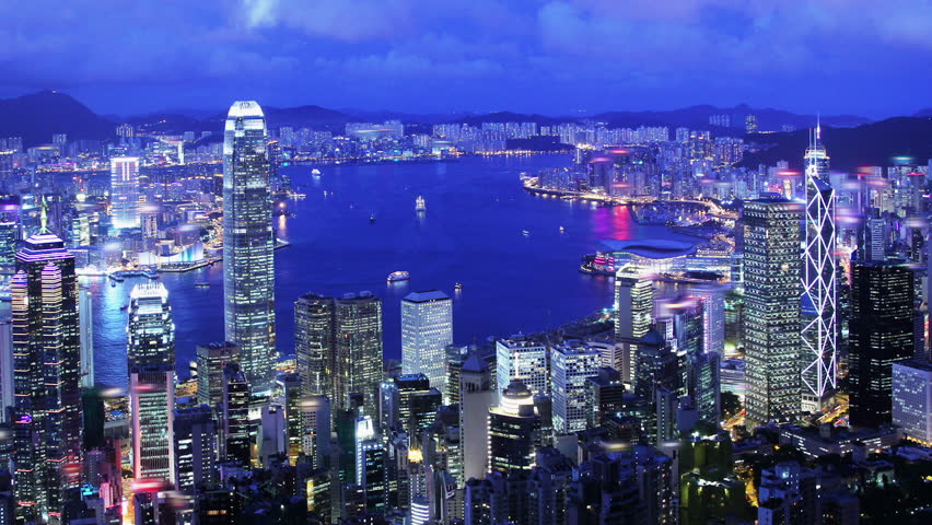 Hong Kong City Night Timelapse. Hong Kong sunset timelapse. Wide and high angle view from the Peak of Hong Kong. Corporate buildings and busy traffic under clear night sky. | Shutterstock HD Video #5609057