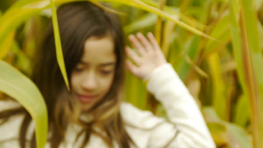 Girl Steps Out Of A Cornfield and Smiles