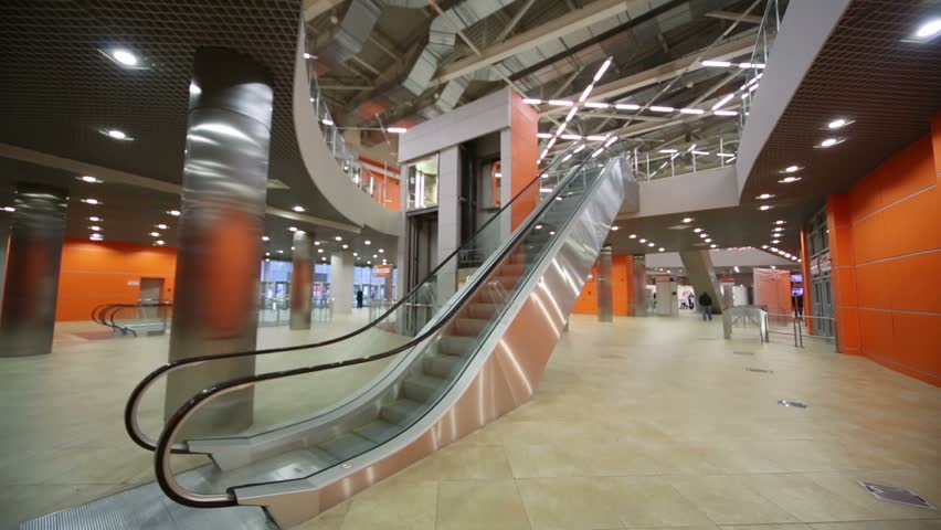 RUSSIA, MOSCOW - OCT 3, 2012: Large hall with lift and escalator in pavilion MosExpo in the OCE.