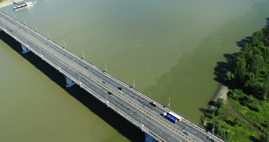 Aerial View. Car traffic on bridge in Barnaul. Bridge over the river Ob. Altai region, Siberia, Russia. Summer 2013