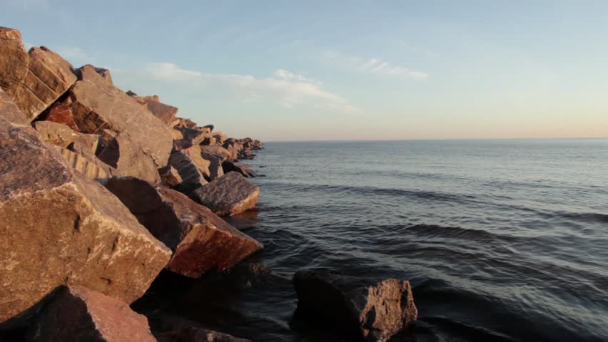 sea ??waves gently beating on granite boulders