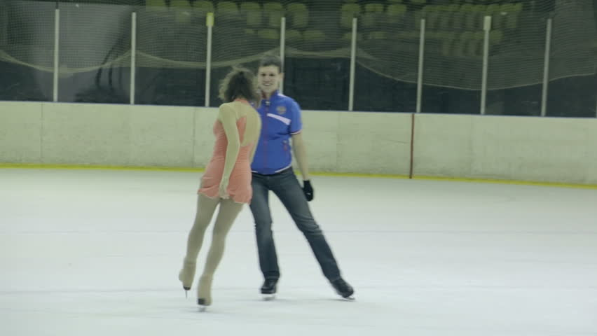 Lovers young Olympic Athletes Skate. Young couple in love, skate