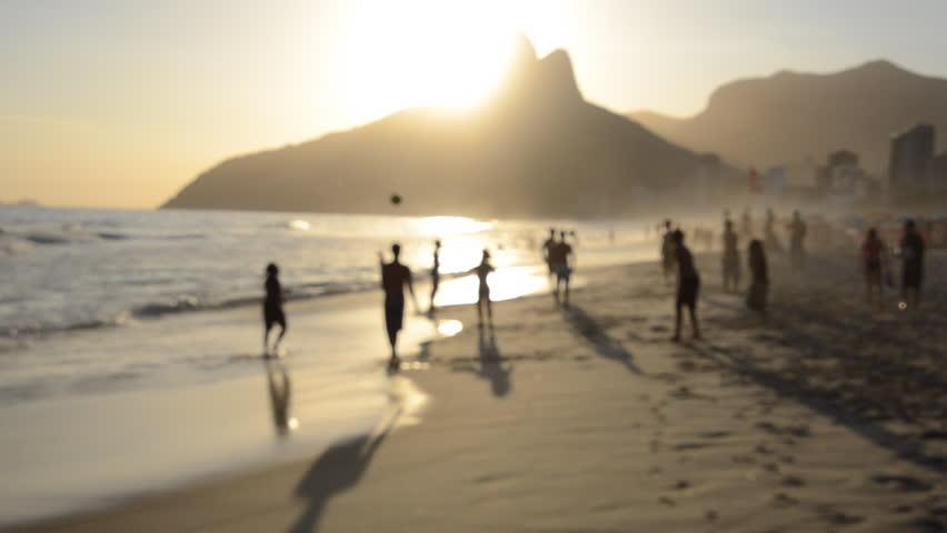 Silhouettes of Brazilians playing beach football at sunset on Ipanema Beach Rio de Janeiro Brazil