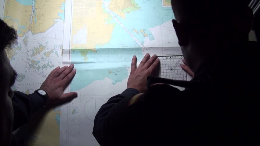 Marines tracing a route with charts