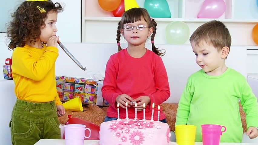 Children Blowing Out Candles on a Birthday Cake ,Slow motion, high speed camera | Shutterstock HD Video #5727032
