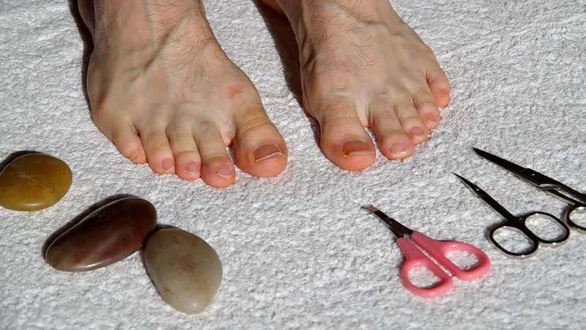Stock video of cutting long toenails with scissors   5752052 ...