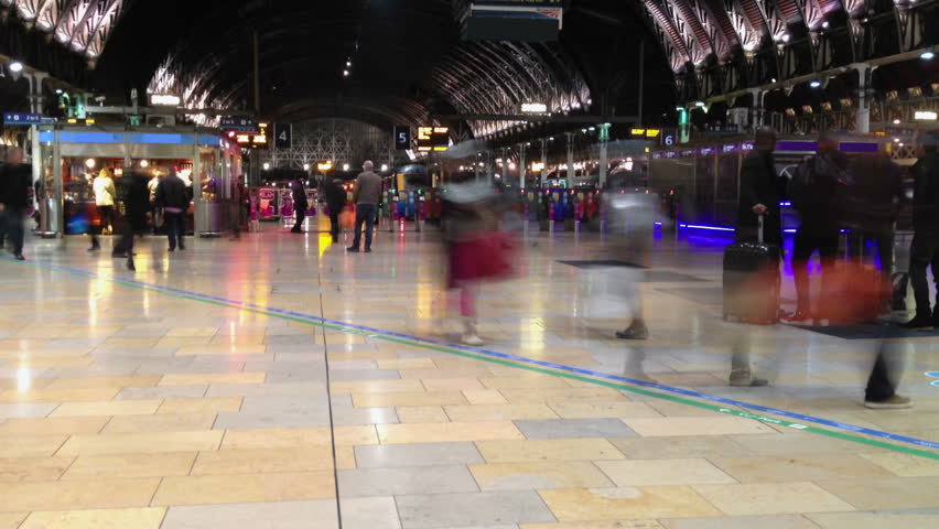 One of Britain's most famous train stations filmed in time lapse. Commuters and travellers on their way home from Paddington on a Friday evening in London.