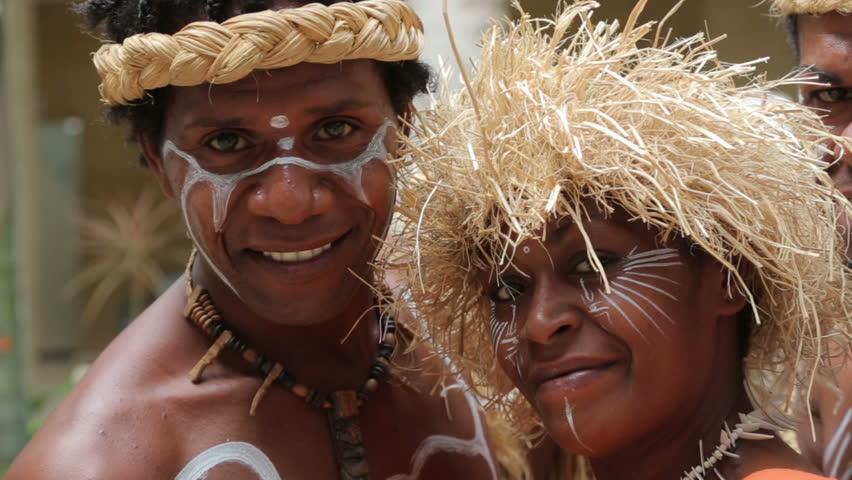 NOUMEA, GRANDE TERRE/NEW CALEDONIA - FEBRUARY 06, 2014: Unidentified Kanak people of Noumea, New Caledonia posing for tourist photographs