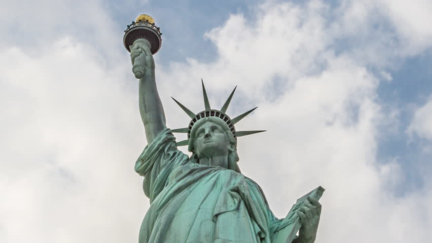Statue of Liberty timelapse close-up over blue sky and clouds | Shutterstock HD Video #5816282