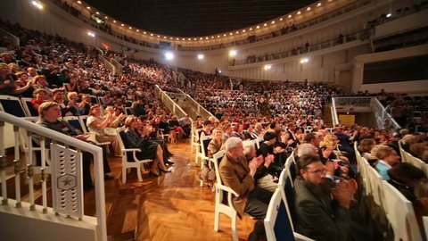 MOSCOW, RUSSIA - SEP 8, 2012: Spectators applaud at IV Grand Festival of Russian National Orchestra in Tchaikovsky Concert Hall.