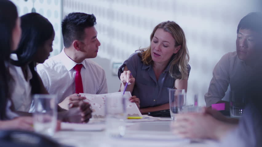 Attractive young multi ethnic business team in a boardroom meeting | Shutterstock HD Video #5843753