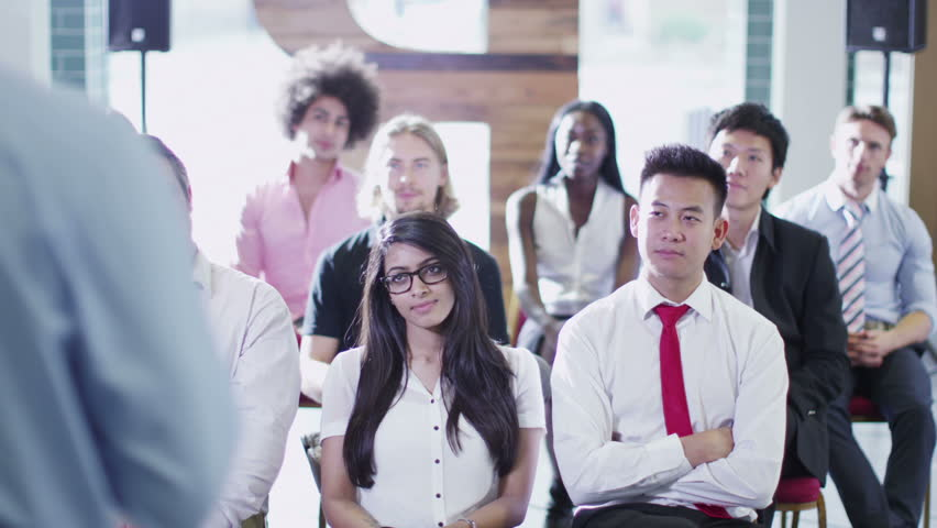 Cheerful diverse business group listening to the speaker at a business presentation or training seminar.  | Shutterstock HD Video #5853290
