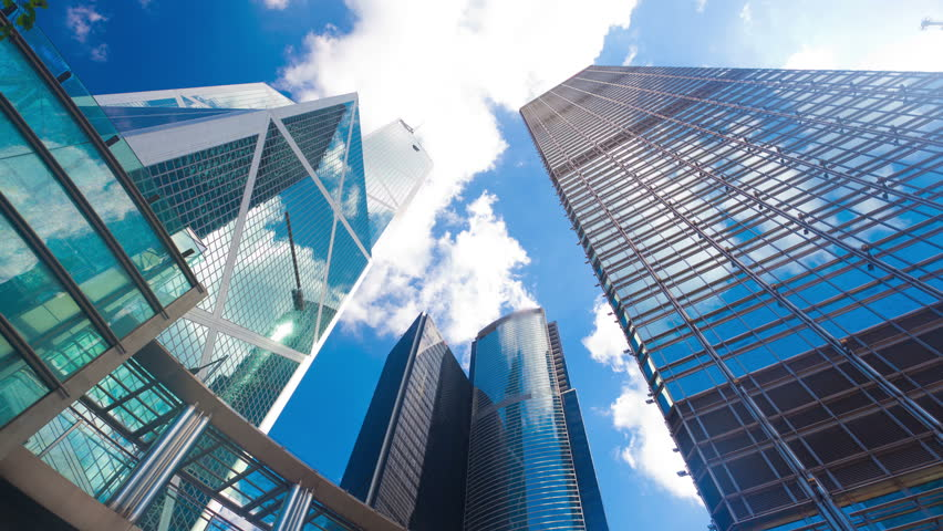 4k timelapse video of office buildings with reflection of clouds #5869472