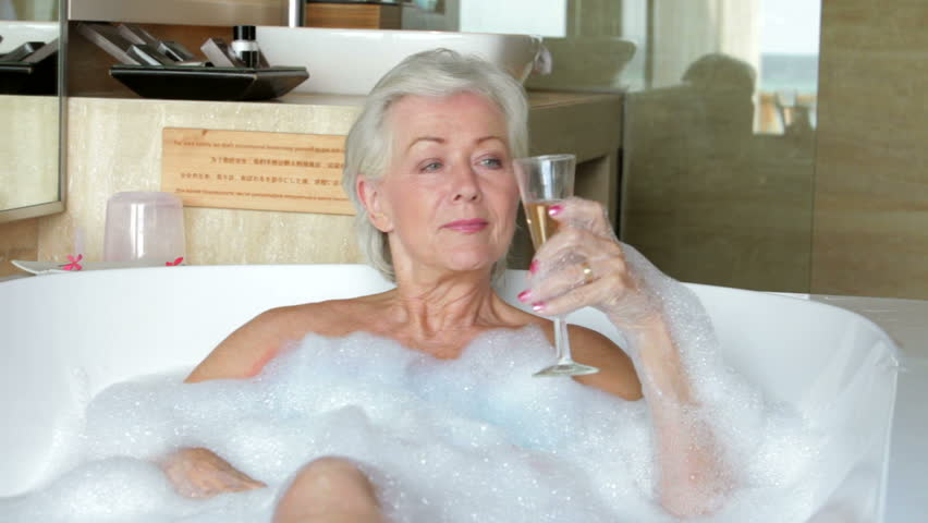 Senior Woman Drinks Champagne As Stock Footage Video 100 -7954