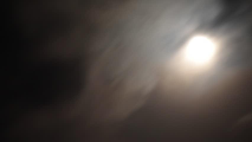 Moon moving between clouds | Shutterstock HD Video #5902742