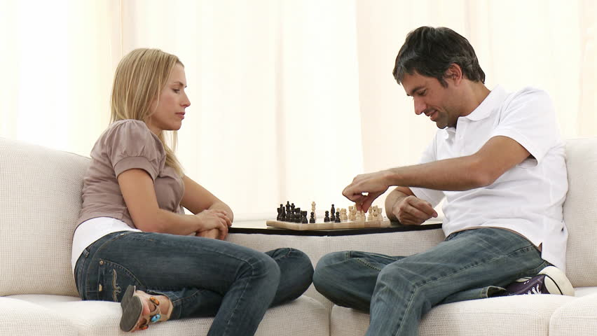 Couple Playing Chess On Sofa In Living Room Footage High Definition
