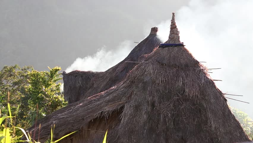 Smoke from a thatched roof in Batad,, northern Luzon, Ifugao province Philippines., next to the rice terraces.