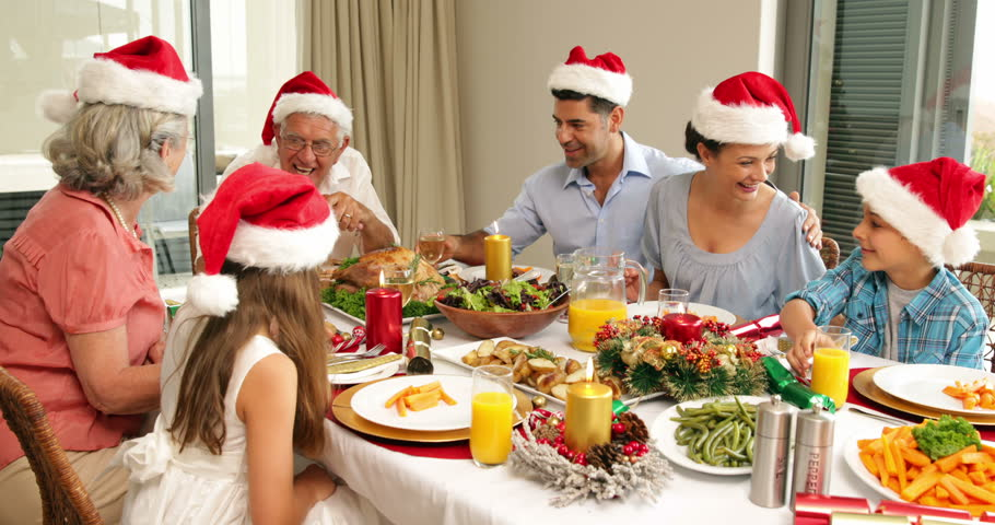 Happy Extended Family At The Christmas Dinner Table Home In Dining Room