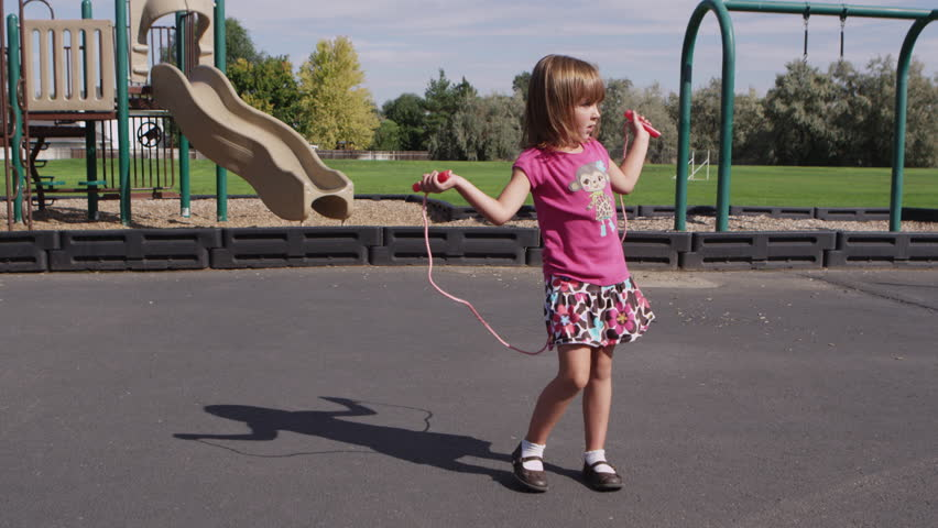 stock video clip of little girl skipping rope at pre
