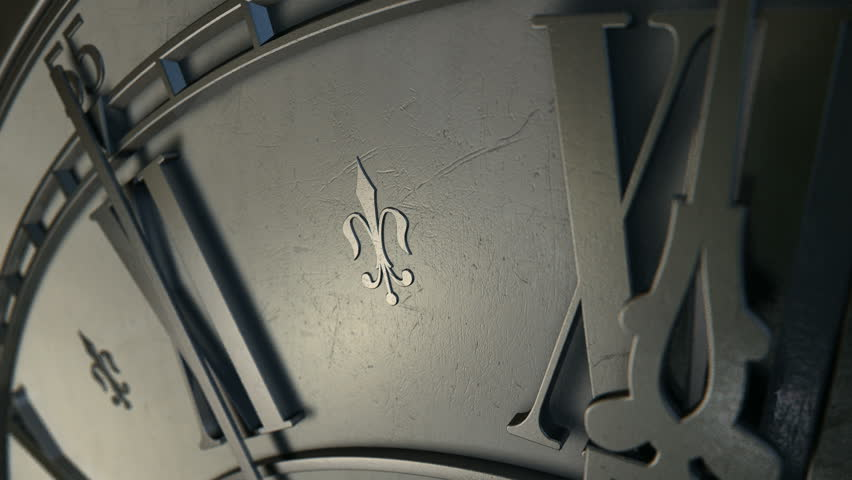 A macro closeup of an antique clock spinning round in a time lapse