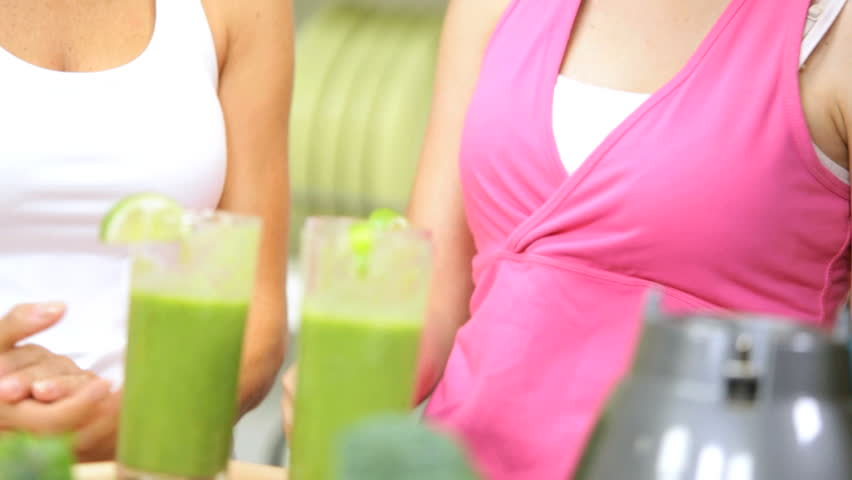 Close up teenage Caucasian sisters mother back from health club domestic kitchen drinking delicious healthy fruit smoothie from electric blender - Healthy Female Family Vegetable Workout Smoothie