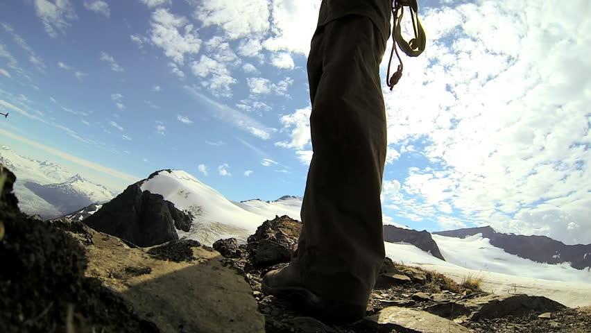 Mountain climber wearing equipment ridge walking Chugach Range of mountains nr Troublesome Glacier, State of Alaska, USA - Mountain climber wearing equipment ridge walking, Alaska, USA | Shutterstock HD Video #5971652