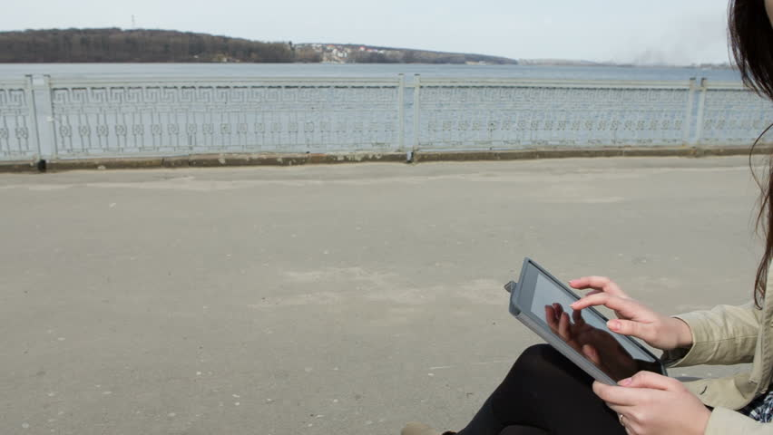 Young woman with tablet on the bench | Shutterstock HD Video #5976446