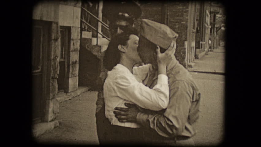 UNITED STATES - CIRCA 1950s: Old home movie film: Woman kissing soldiers