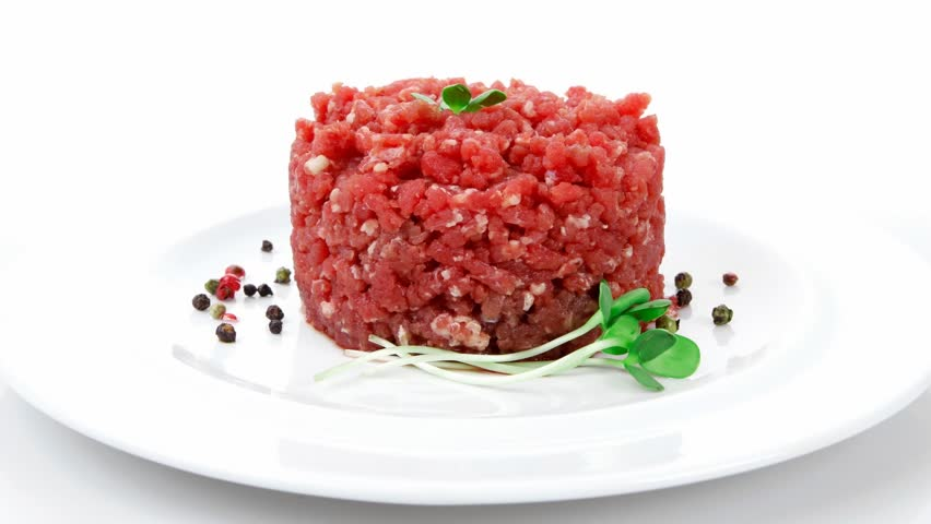 very big raw hamburger cutlet with sprouts and chilli pepper plate 1920x1080 intro motion slow hidef hd