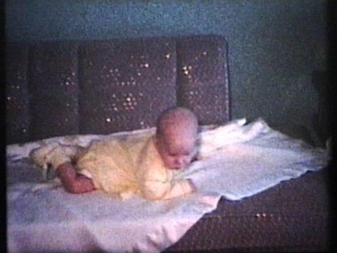 Mother Dressing Baby For Winter (1963 - Vintage 8mm film)