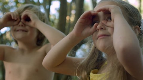 Excited Little Kids Search For Something In The Trees With Pretend Binoculars