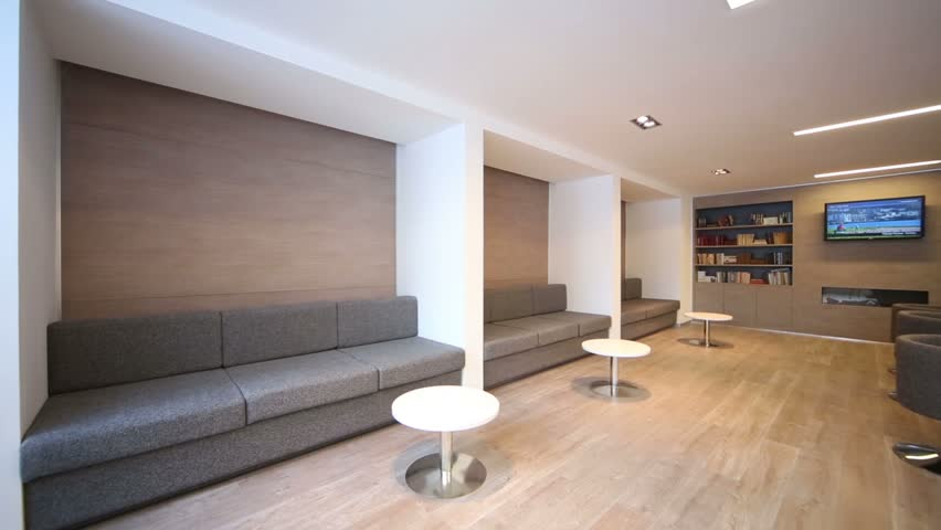 Rest-room with sofas and reception hall at modern business center
