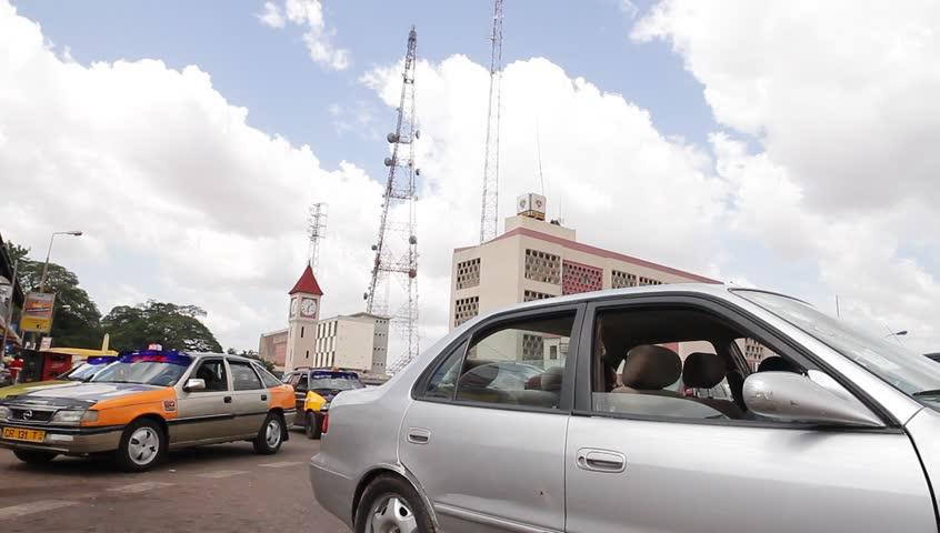 KUMASI, GHANA AFRICA -MAY 2013, camera pan against the sky cars in traffic   Shutterstock HD Video #6049172