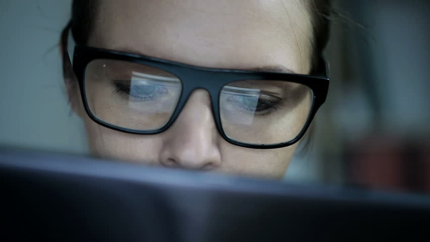 Woman in glasses watching something on tablet computer