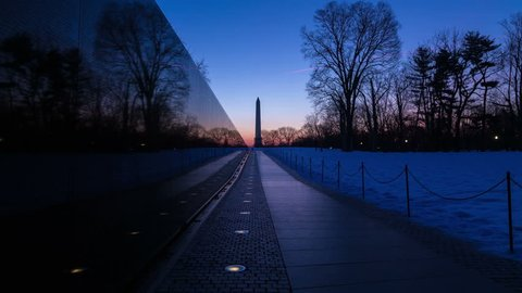 Washington D.C. - Time-lapse of sunrise reflecting in Vietnam Memorial Wall with Washington Monument in the background