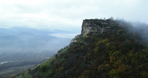 Aerial View: Besh-Kosh mountain, near Bakhchisaray. Crimea. Autumn 2013. The outer ridge of Crimean mountains is a series cuesta gradually rise to about 350 m.