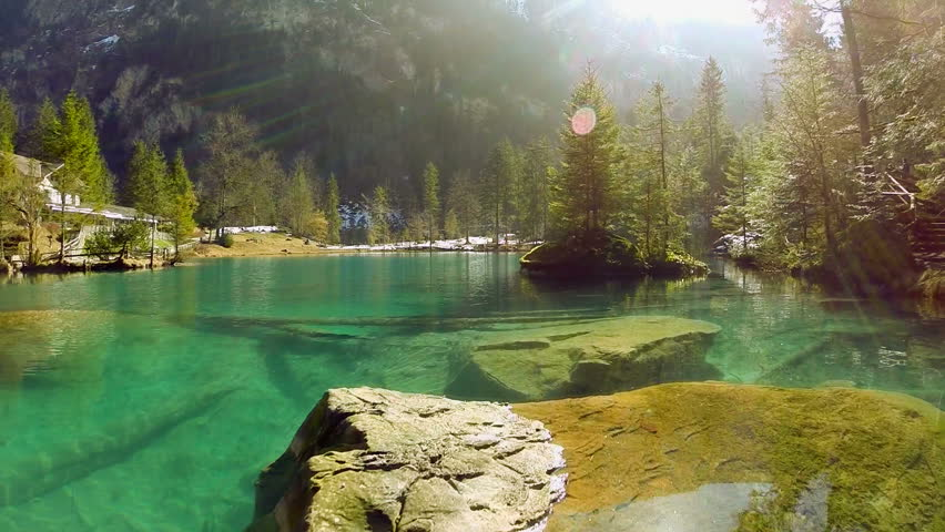 Turquoise Lake Water. Fly Over. Stock Footage Video (100%