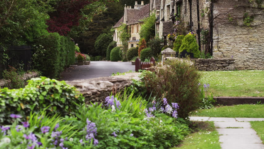 Wide Shot Village with stone houses / Castle Combe, Cotswolds, Wiltshire, UK