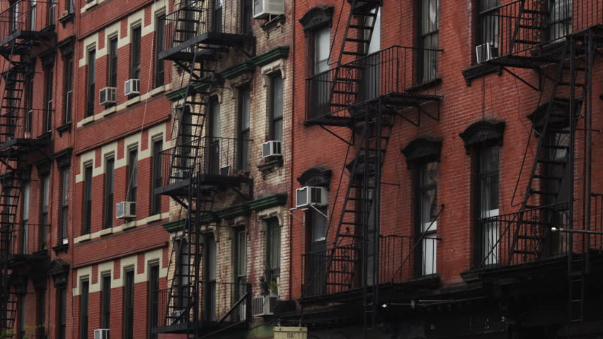 Medium Shot Exterior Of Brick Apartment Building New York City