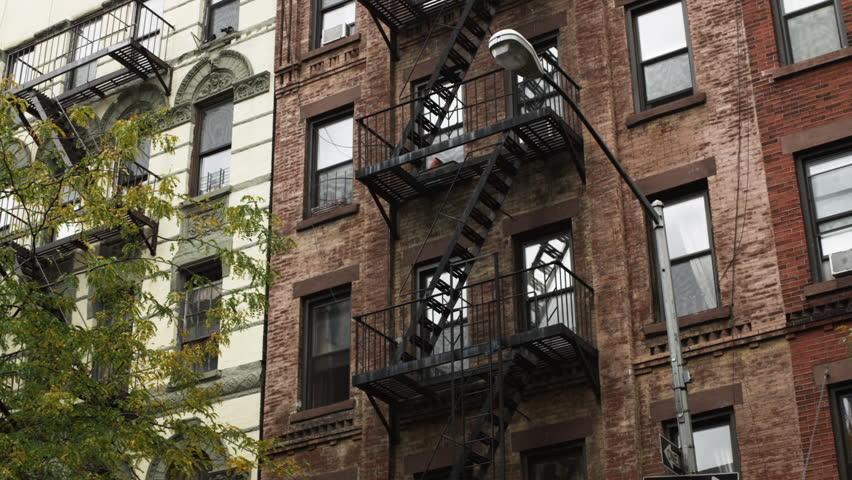 Apartment Building Exterior medium shot pan exterior of apartment building with fire escape