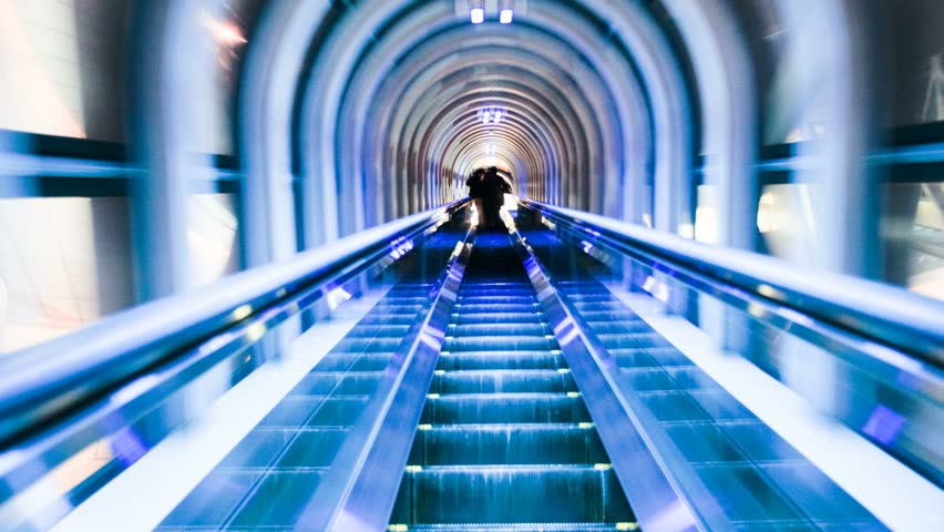 Motion time lapse going down an escalator in Osaka, Japan