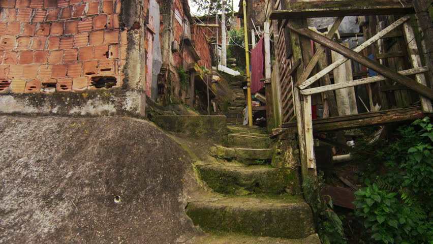 Tracking shot of shanties along the stairs in a favela in Rio de Janeiro, Brazil