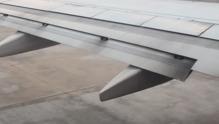 Aircraft Wing Flap And Aileron Moving While The Flight Stock
