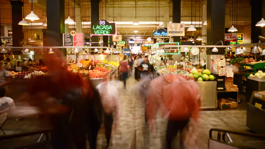 LOS ANGELES, California - April 9th: Time lapse Photography with tilt up motion of unrecognizable shoppers gather at historic Grand Central Market in Downtown Los Angeles on April 9th.